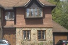 Brick and Tile clad timber frame house Woodward Chartered Surveyors