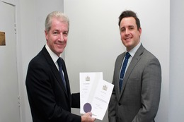Lewis Emms receives Charter from Dr Stephen Cornish